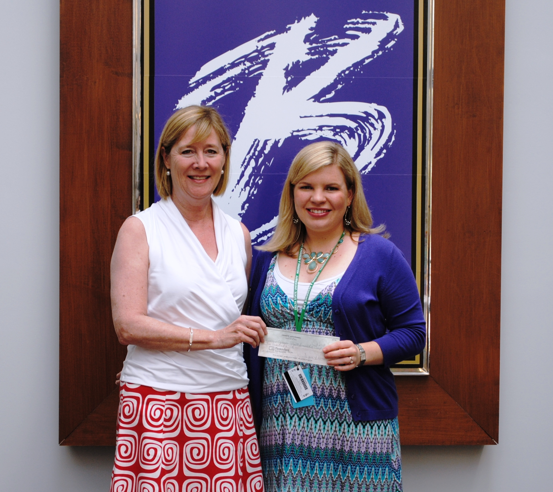 See Attachment Photo Signe Adams, Crosstie Arts Council Treasurer, presents a check for the Janice Wyatt Mississippi Summer Arts Institute to Whitney Cummins, BPAC Arts Education Coordinator.