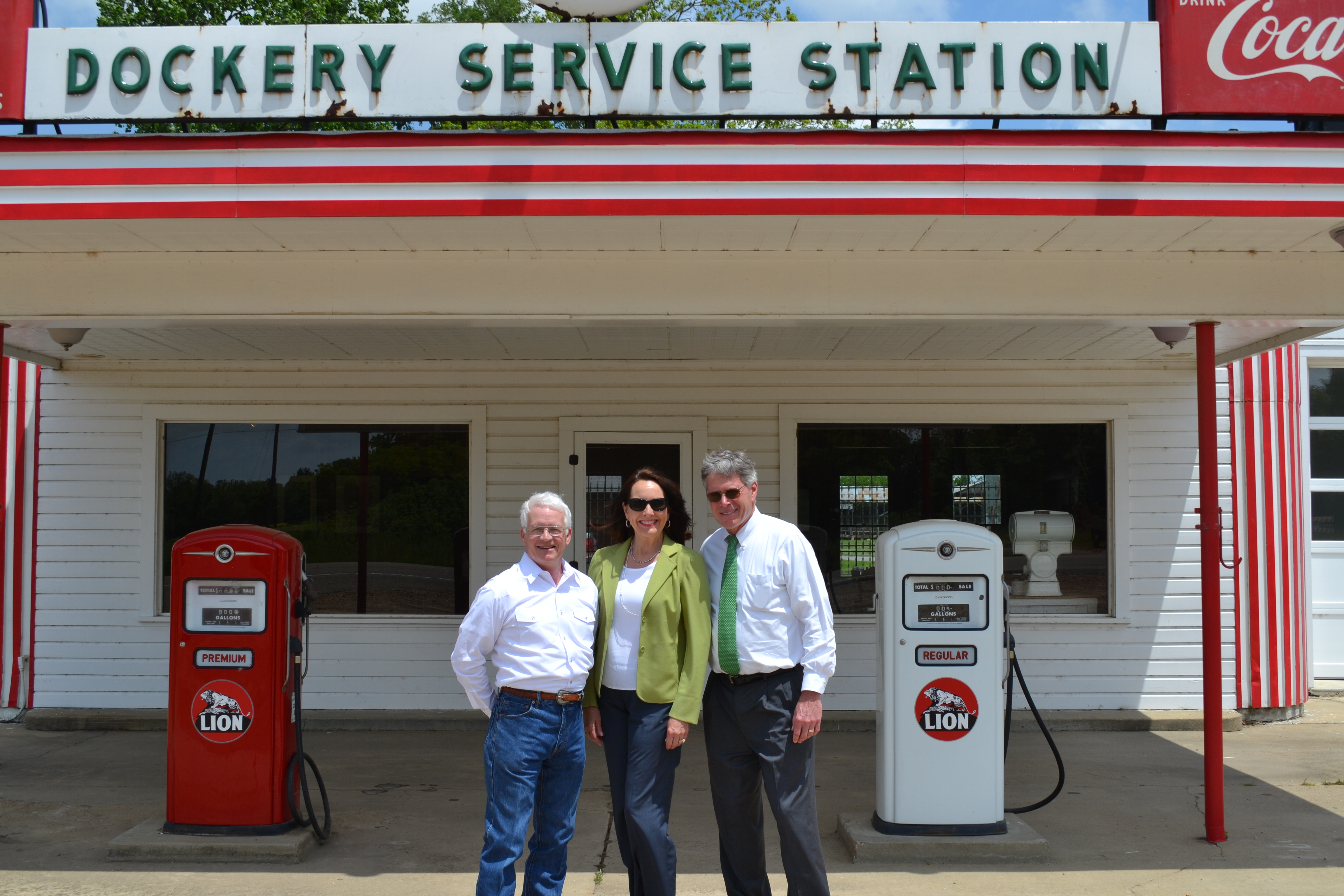 From left, Delta State Professor Emeritus of Art and Coordinator for the Dockery Farms Foundation Bill Lester, Delta State First Lady Nancy LaForge and Delta State President William N. LaForge in front of the history Dockery Service Station.