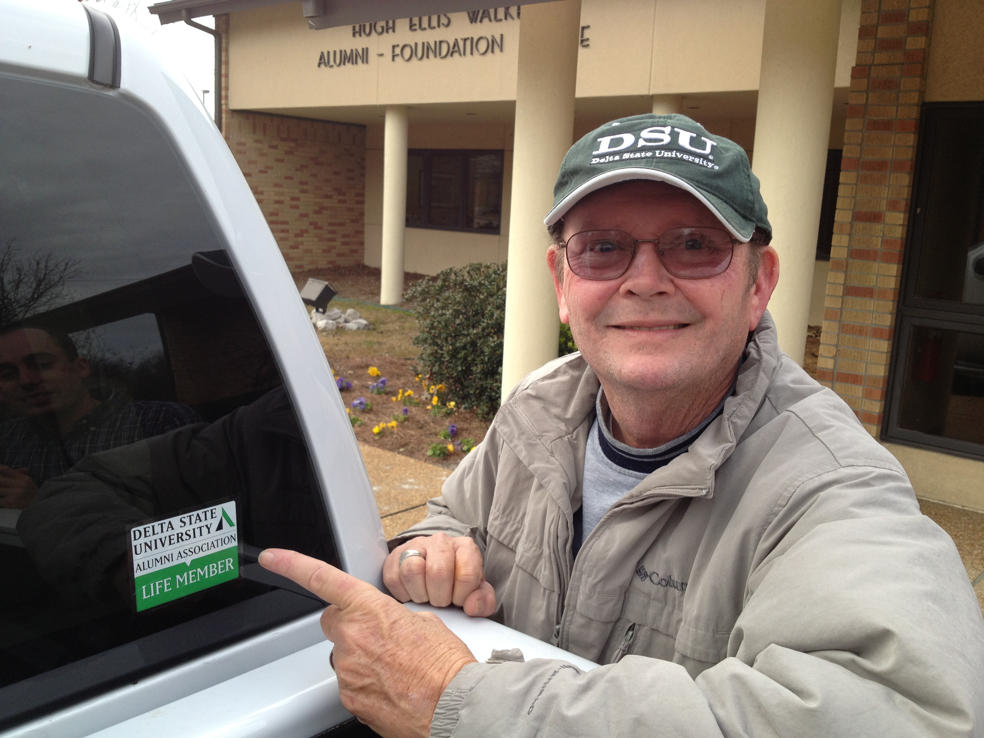 Photo: James Donald Cooper ('63), Registrar Emeritus, shows off his DSU Alumni Association Life Member Decal.