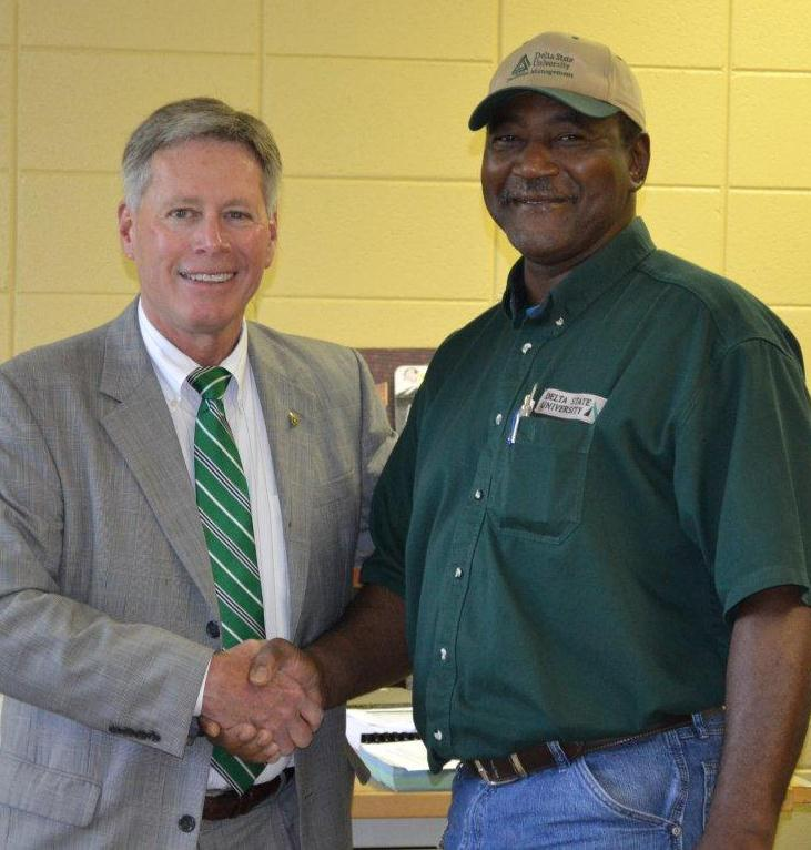 President LaForge shakes employee of the month Michael Kemp's hand in congratulations.