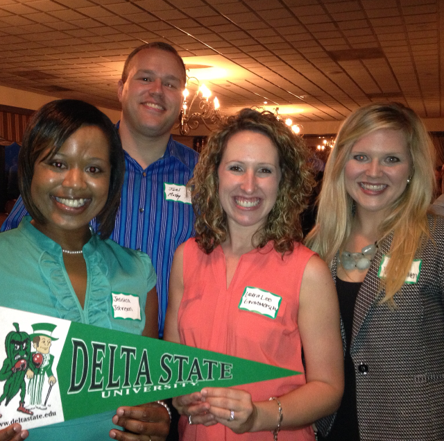 Photo:  The new Memphis Chapter Officers showing some Delta State spirit. L to R:  Jessica Johnson, past president; Joel Mosby, president; Laura Lee Grommersch, vice president; and Kate Kinnison Van Namen, secretary/treasurer.