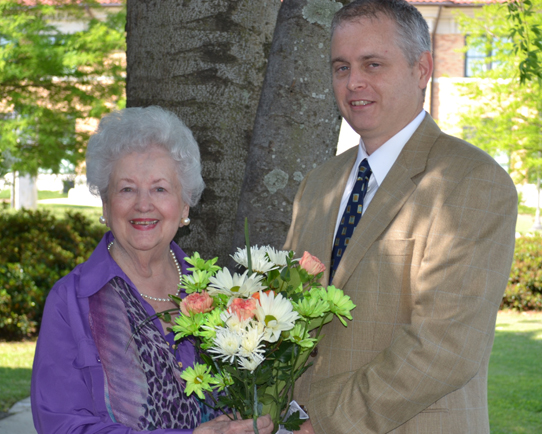 From left, Mrs. Jutta Karnstedt Ferretti accepts flowers from Dr. Mark Bonta, Associate Professor of Geography and Chair of the MA-LS Committee at Delta State, during a recent ceremony honoring the establishment of the John S. and Jutta Karnstedt Ferretti Fellowship.
