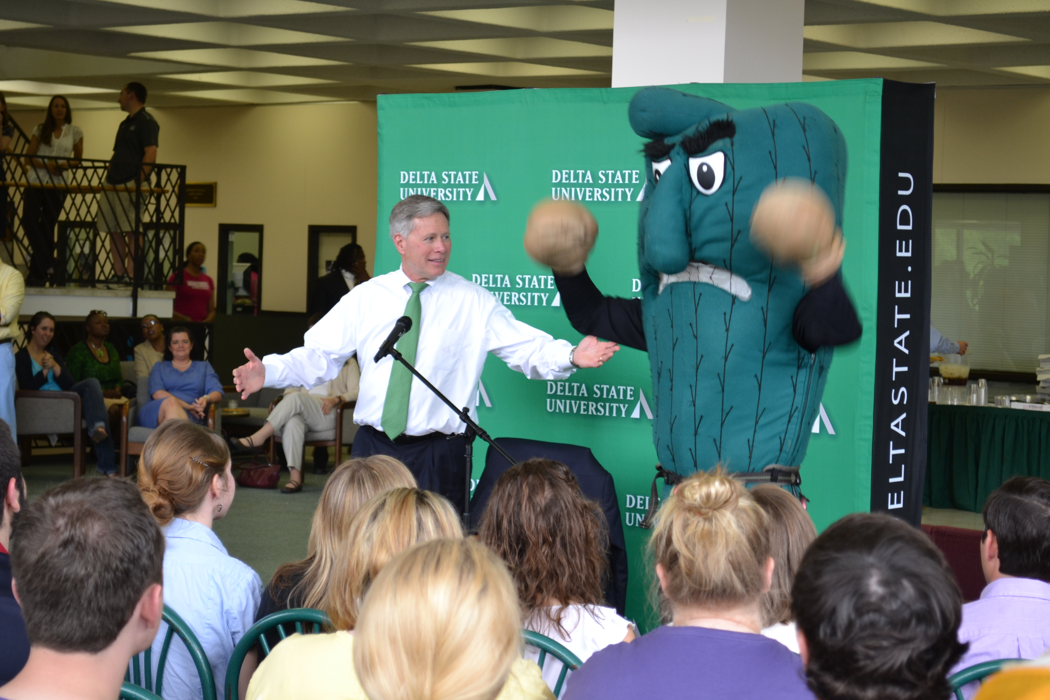 "Delta State President William N. LaForge and the Fighting Okra are all ""smiles"" as the flash mob concludes."
