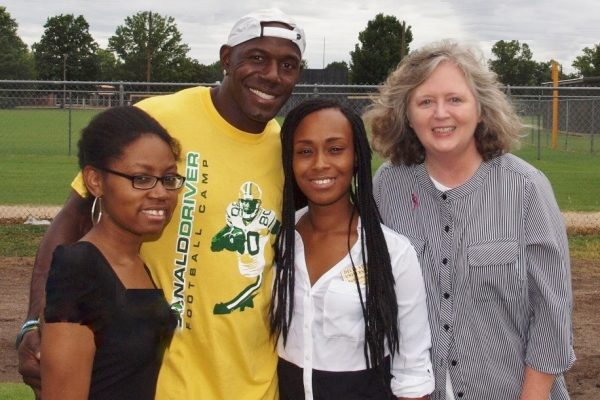 The purpose of this partnership was to promote breast cancer awareness at the Donald Driver Football Camp on June 26, 2014 at Cleveland High School. Camp participants wore pink Running Komen ribbons on the camp t-shirts. Pictured: Sharon Grose, Donald Driver, Aubreisha Hackler, and Gail Bailey.