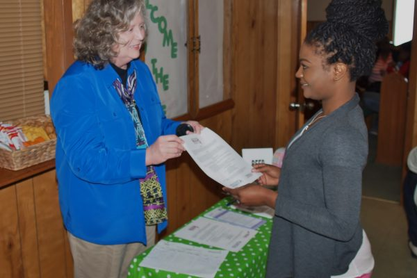 Gail Bailey, Project Coordinator for the Breast Education and Early-detection Project at Delta State discusses the importance of early detection with a participant at health fair at Cornerstone Church on March 28, 2015 in Cleveland, MS.