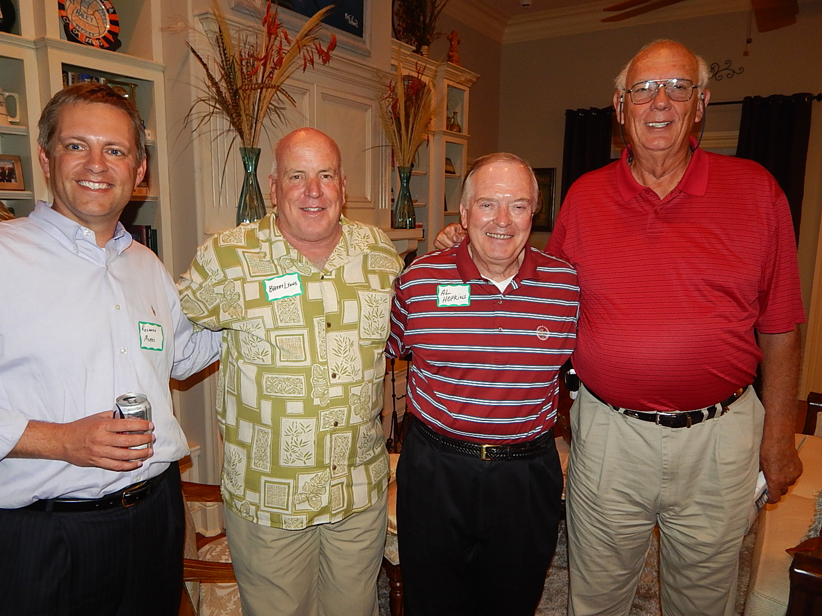 Photo: Richard Myers, National Alumni Association President; Barry Lyons, General Al Hopkins, and Tommy McKiernon enjoying each other's company at the alumni meeting.