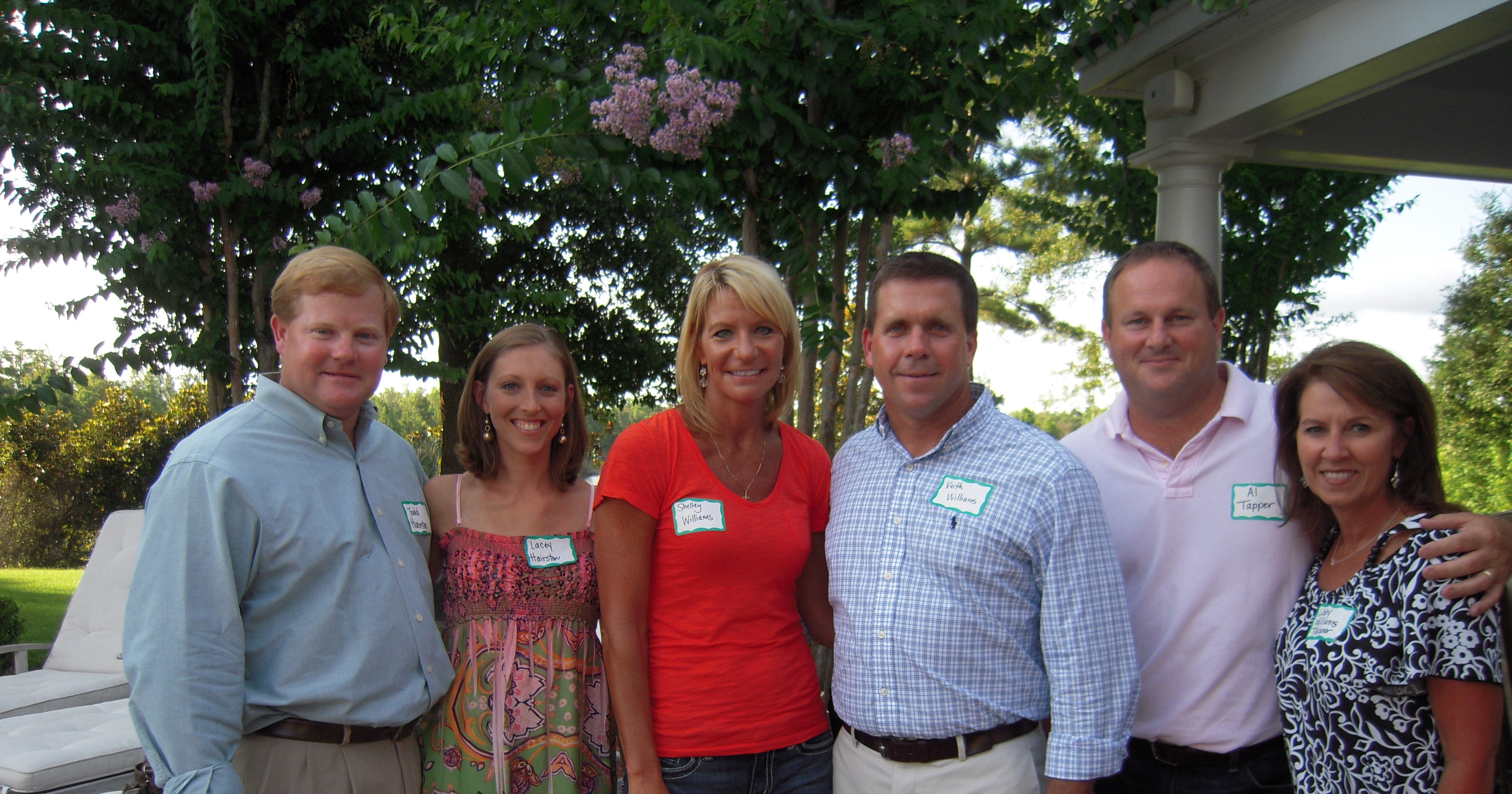PHOTO:  From left,  Todd Hairston, Lacey Hairston, Shelley Williams, Keith Williams, Al Tapper, and Libby Williams Tapper at a past Gulf Coast event at the home of Dr. Johnny Mallett.