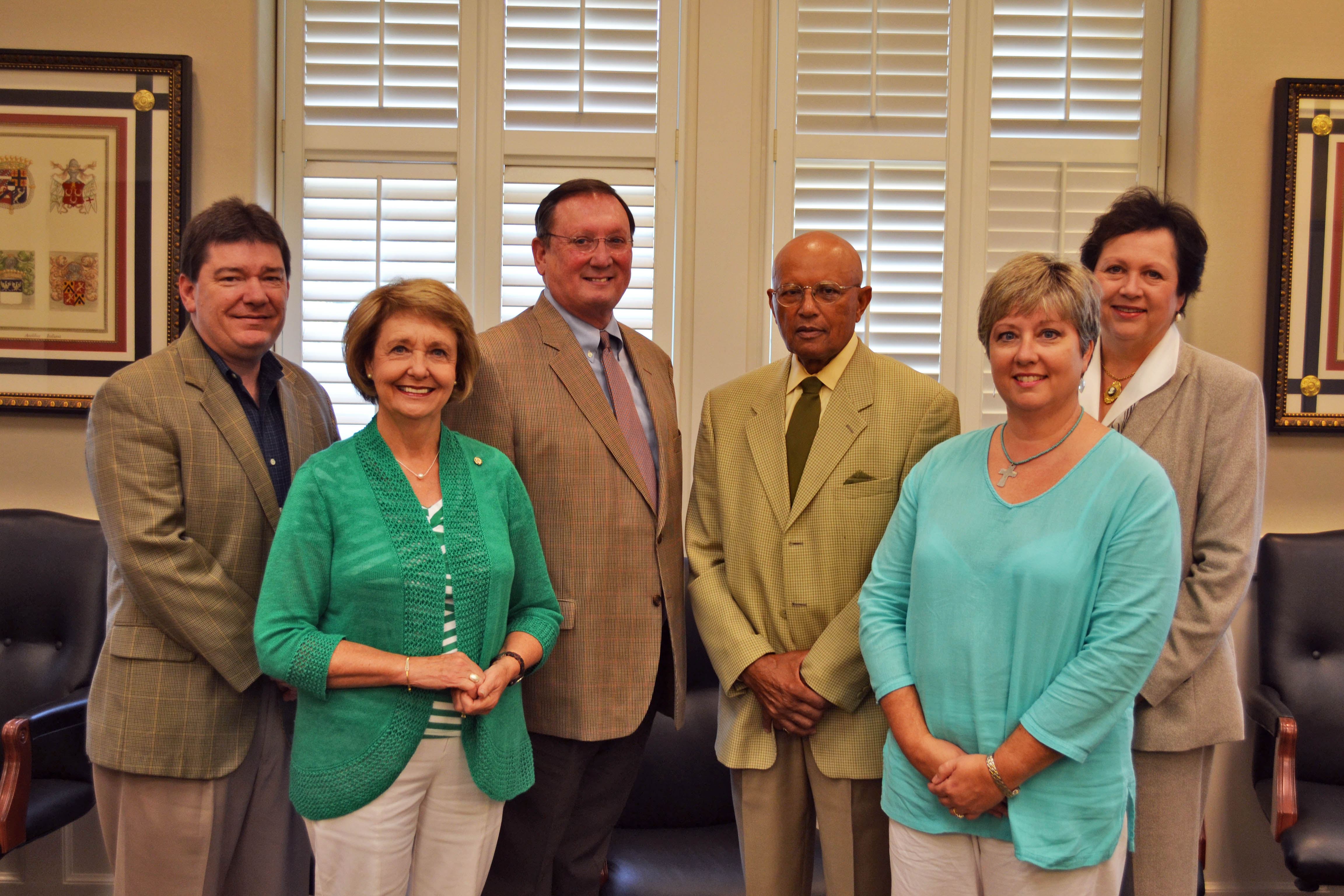 PHOTO:  The advisory board's members include Vicki Fioranelli, Dr. Cass Pennington, Peter Jernberg, Beverly Johnston, and Dean of the College of Education and Human Sciences, Leslie Griffin. Not pictured is Butch Scipper. Gary Bouse was present as an Alumni Foundation representative.