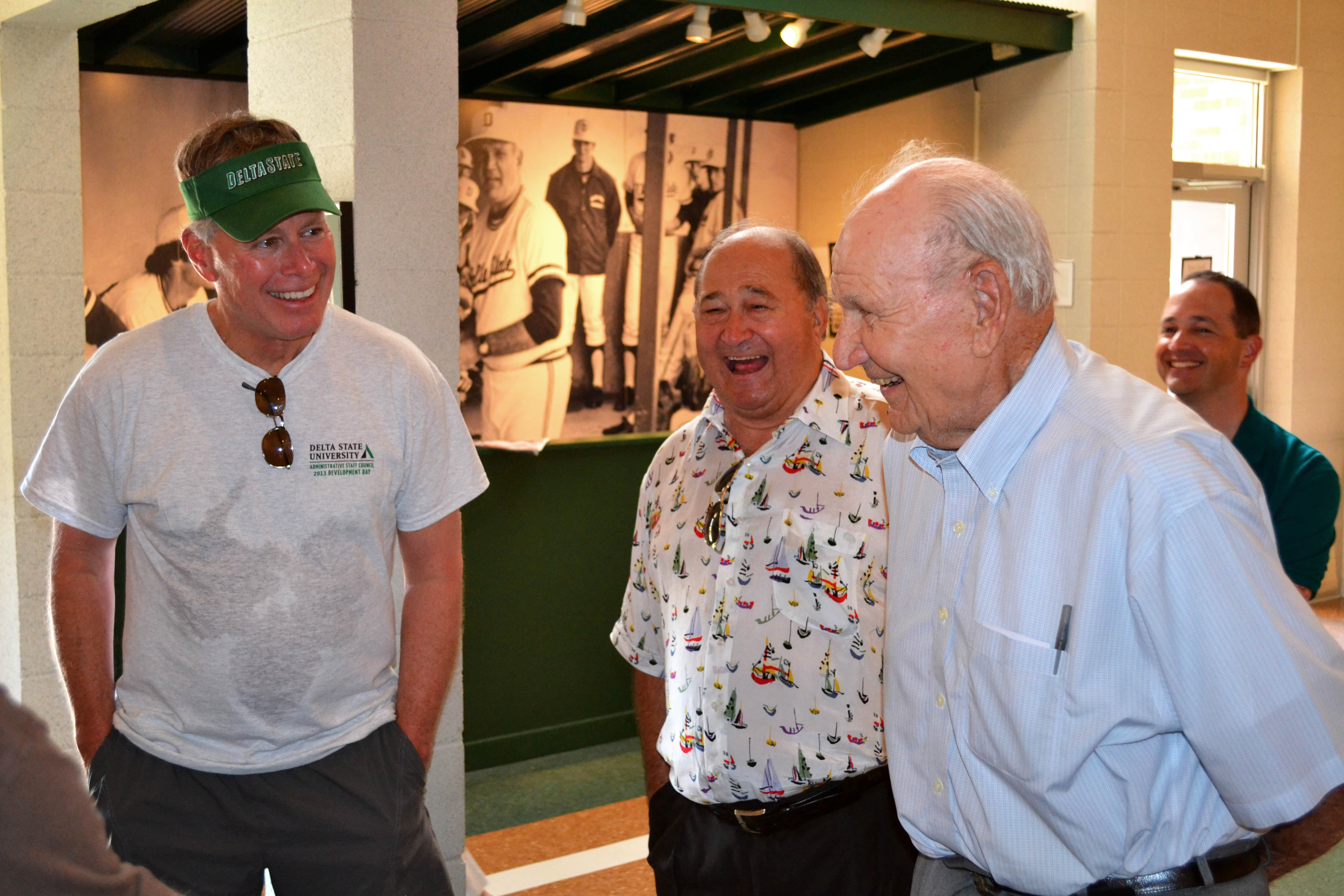 "PHOTO: President William N. LaForge, Jack Davis, and Coach Dave ""Boo"" Ferriss share a laugh while touring the museum."
