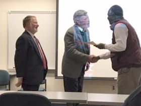 President LaForge and Provost McAdams present award to Dr. Kagumba