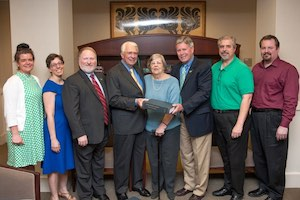 Dr. Steen presents book to DSU