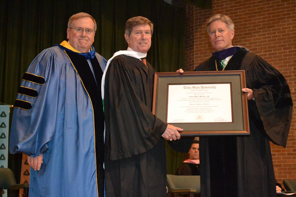 Delta State University President Emeritus Dr. John M. Hilpert (left) and new Delta State University President William N. LaForge (right) bestow Delta Council Executive Vice President Chip Morgan with one of the university's highest honors - an honorary Doctor of Public Service degree.