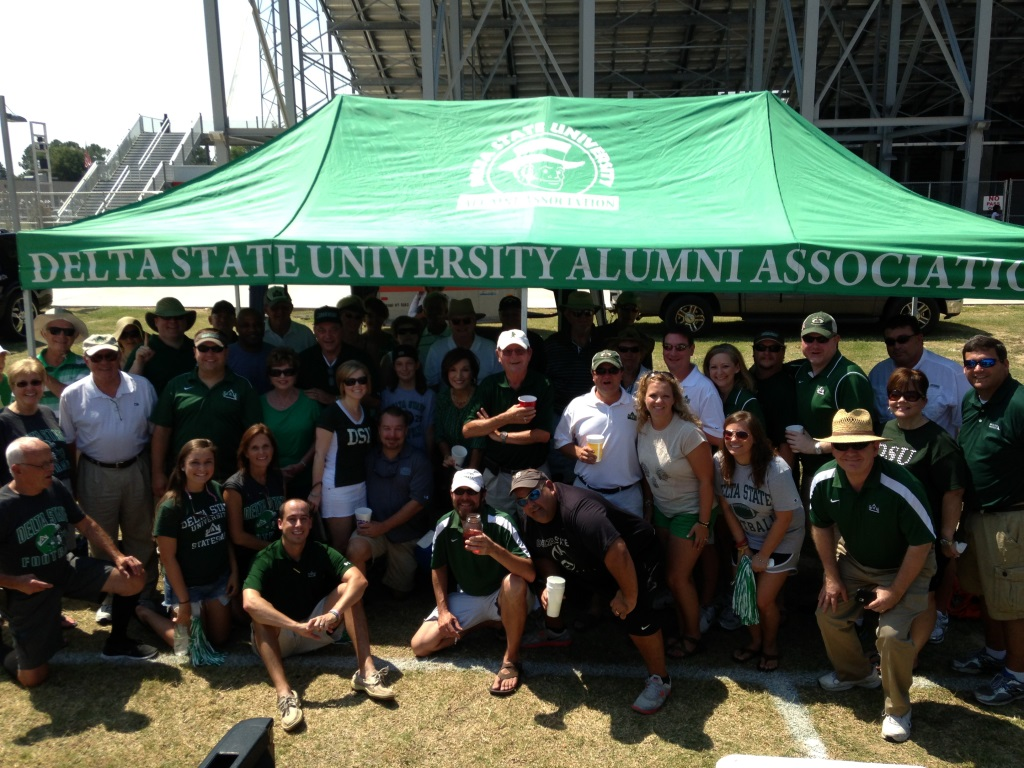 University friends tailgate at the Alumni Association tent in Itta Bena.