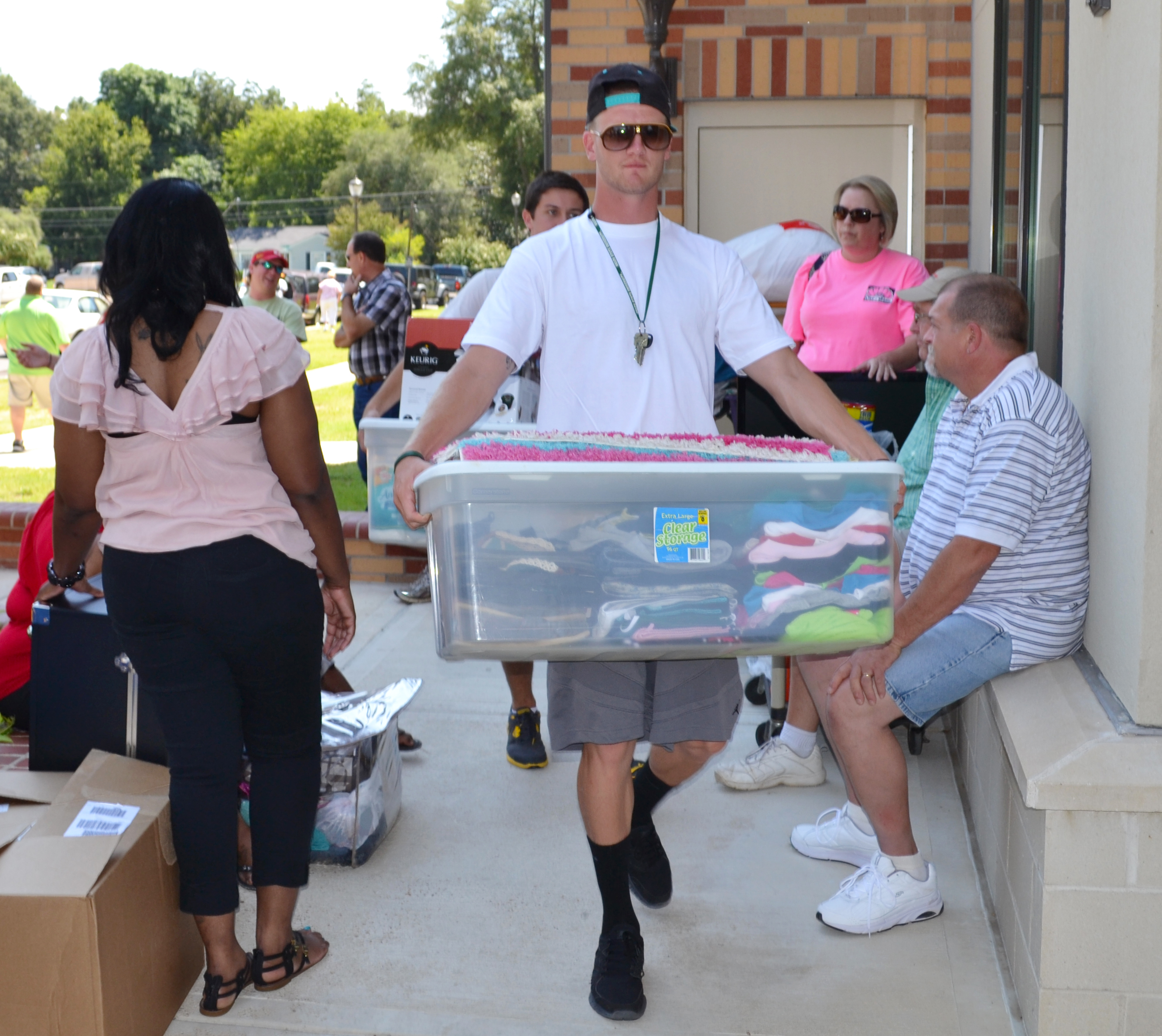 Athletes help carry items in residence halls.
