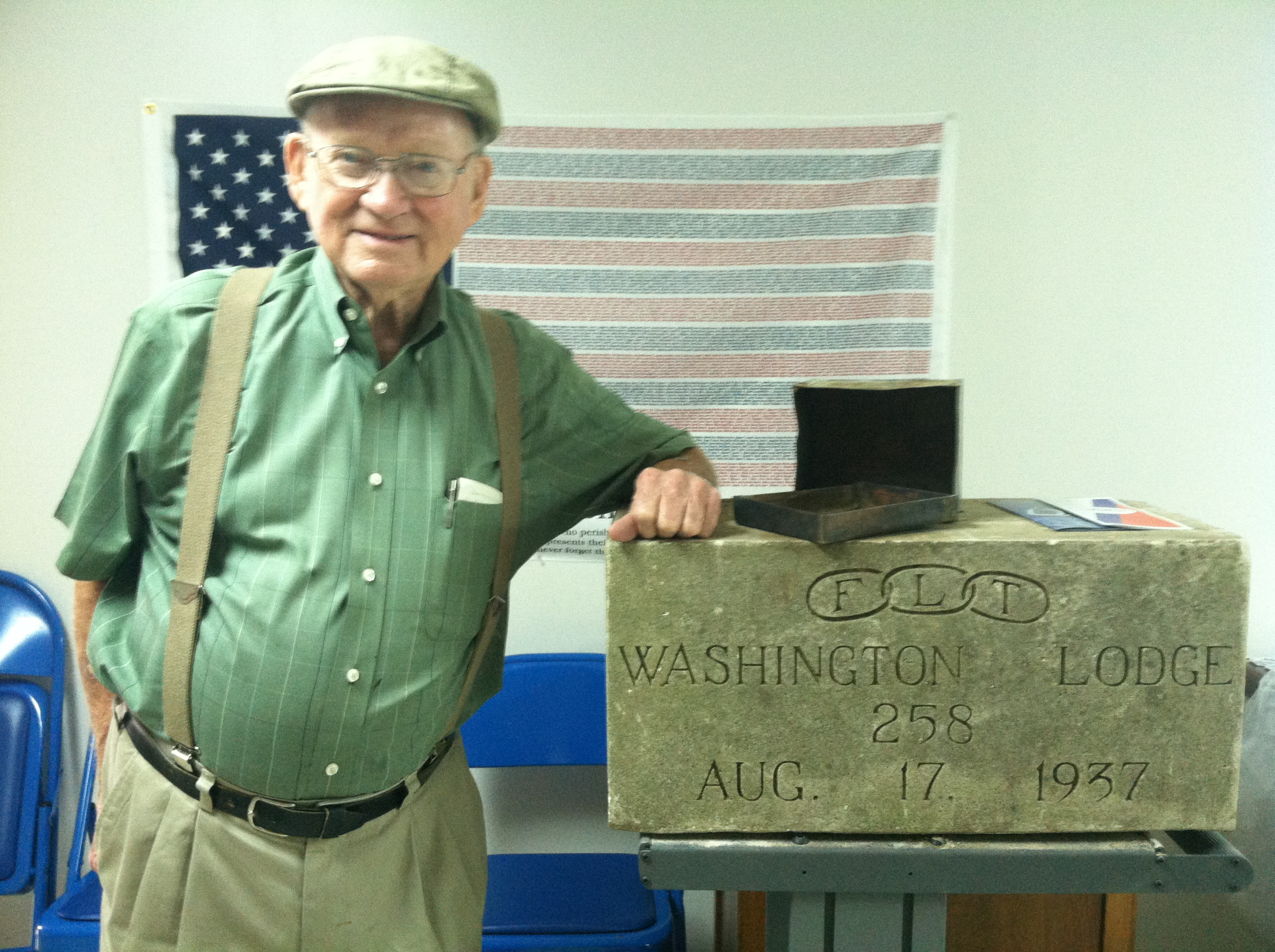 man with time capsule contents at Delta State Archives