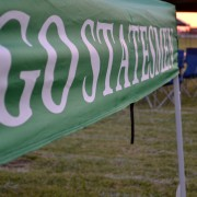 Go Statesmen on side of the tent