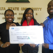 Marquita Dorsey (left), SAM health advocacy coordinator and Derrick Price (right), AmeriCorps*VISTA member present a check to Satoria Hall, winner of the 50/50 Bear Bucks Raffle.