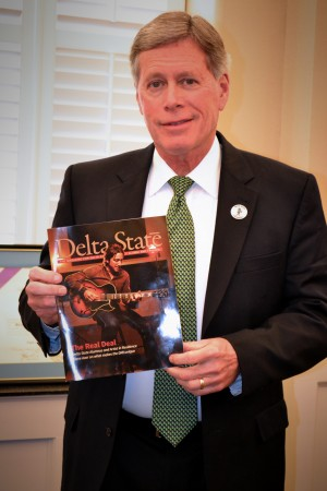 President LaForge shows off his copy of the Alumni and Foundation Magazine.
