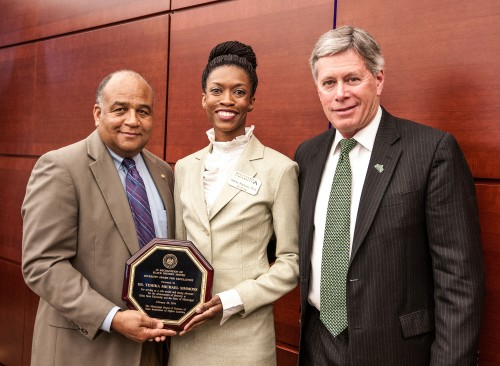 Dr. Temika Simmons (center), assistant professor of psychology at Delta State, received a diversity award on Feb. 20 from C.D. Smith (right), chair of the IHL Board of Trustees Diversity Committee. Also in attendance was Delta State President William N. LaForge.