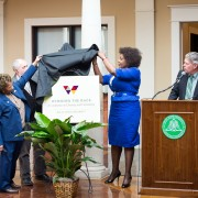 "Delta State University held a press conference today to announce ""Winning the Race: A Conference on Diversity and Community."" Unveiling the logo were (l to r) Georgene Clark, Garry Jennings, Paulette Meikle-Yaw and President William N. LaForge."