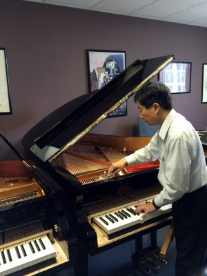 Takanori Otake, master piano artisan with Shigeru Kawai Pianos, worked on four new grand pianos this week that were recently acquired by the Delta State University Department of Music.