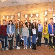 "Visiting Oregon students examined ""The Cast of Blues"" collection by artist Sharon McConnell."