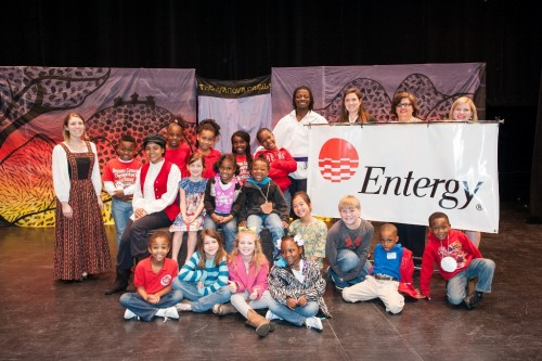 Students who participated in The Emperor's New Clothes pose with the cast of the show, Cheryl Comans of Entergy Mississippi, and Laura Howell and Whitney Cummins of the Bologna Center.