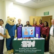 Monica Stinson (left), MSDH asthma program coordinator; Wheezy Bear, SAM mascot, Beverly Moon, dean of Graduate and Continuing Studies and Research; Evelyn Jackson, RRT of the Pulmonary Rehabilitation Center; Alexis Hynes, AmeriCorps VISTA member; Derrick Price, AmeriCorps VISTA member; Marquita Dorsey, Health Advocacy coordinator; and Billy Nowell, mayor of Cleveland, recently celebrated World Asthma Month.