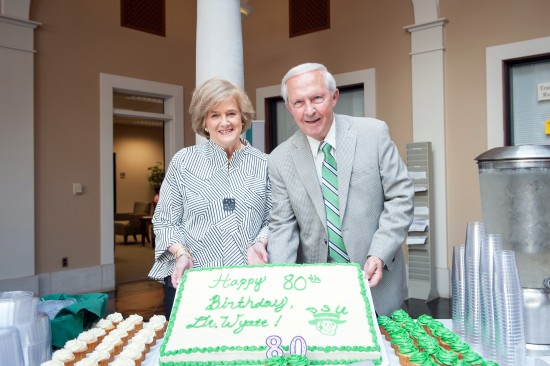 Former Delta State President Kent Wyatt and his wife, Janice, share the cake designed in celebration of the president's 80th birthday Tuesday.