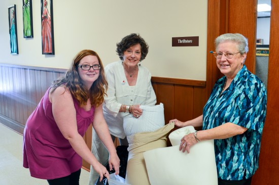 Heather Miller (left) and Lee Aylward of the Delta Center for Culture and Learning, visit Sister Donald Mary Lynch of St. Gabriel's Mercy Center in Mound Bayou with a donation of bedding.