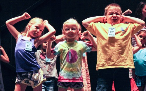 Campers flex their muscles as they rehearse a song performed at the annual PLUS Camp at the Bologna Performing Arts Center.