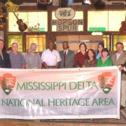 Representatives of the Mississippi Delta National Heritage Area Partnership (left to right): Dr. Luther Brown, former Director of the Delta Center for Culture and Learning; Frank Howell, Delta Council; Ken Murphree, former Governor's Appointee to the MDNHA board; Mike Madell, Vicksburg National Military Park, National Park Service;  Dr. Bernard Cotton, Alcorn State University;  Spencer Nash, Delta Foundation;  Myrtis Tabb, Delta State University;  Kappi Allen, Bolivar, Coahoma, Quitman, and Tallahatchie counties;  Paula Sykes, Washington, Sunflower and Issaquena counties;  Meg Cooper, Warren, Yazoo, and Sharkey counties; Tom Pearson, Mississippi Arts Commission; Dr. Rolando Herts, Director of the Delta Center for Culture and Learning. Photo by Roy Meeks.