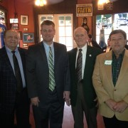 Floyd Eppionette '57 (left), coach Todd Cooley, Fred Foster '55 and Newt Willis '74 at last year's Natchez social.