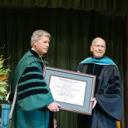 President William N. LaForge (left) congratulates Governor William Winter with an honorary doctorate today at Delta State University's 88th Commencement.