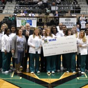 Chuck Stinson, director of Community Services & Relations at the Mississippi Organ Recovery Agency, presented a trophy and $500 check Thursday to the Delta State University Student Nurses Association after leading the university to a victory in the 2014 Donor Challenge.