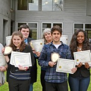 Delta State journalism students Laura Orsborn (left to right), Elisabetta Zengaro, Conor Bell (back row), Tiago Doneux, Aallyah Wright and La Tia Penn display a record number of Mississippi Press Association awards for news, editorials, features, photography, graphic design and general excellence. The awards were presented at the annual Better Newspaper Contest in Jackson on  March 26. Associate professor Patricia Roberts, Delta Statement advisor, is  fourth from left.
