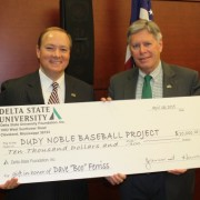 "Delta State University President William N. LaForge, right, presented a donation from the DSU Foundation to Mississippi State University's Dudy Noble stadium baseball project to MSU President Mark E. Keenum, left, prior to Thursday's meeting of the state College Board in Jackson. The gift honors former MSU baseball great and longtime DSU coach and administrator David M. ""Boo"" Ferriss. Ferriss was MSU's first scholarship baseball player and went on to a remarkable career in Major League Baseball with the Boston Red Sox."