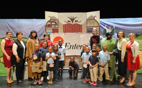 Students from Booker T. Washington Elementary School in Clarksdale who attended The Reluctant Dragon pose with the cast of the show, Betty Wong of New Stage Theatre, Cheryl Comans of Entergy Mississippi, and Laura Howell and Whitney Cummins of the Bologna Center.