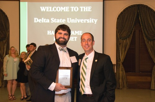 Jeffrey Farris (right), director of Alumni Affairs, recently congratulated student Brooks Bishop for winning the H.L. Nowell Student Alumni Association Service Award at the annual Student Hall of Fame Banquet.