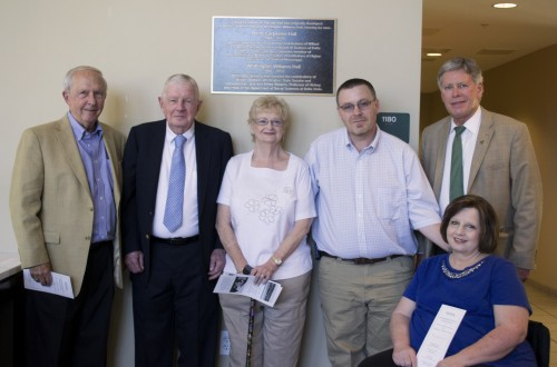 President Emeritus Kent Wyatt, Willard  Bond, III, Donna Bond, Tom Farley, Barbara Farley, and President William LaForge are pictured in front of the plaque in Foundation Hall.