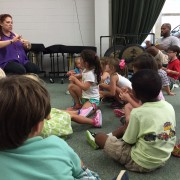 Storyteller Carrie Sue Ayvar, left,  works with PLUS Campers participating in this year's camp at the BPAC. The final performance for the camp is July 18 at 10 a.m. and is free and open to the community.