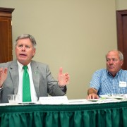 Delta State University President William N. LaForge (left) addresses mayors from across the Delta for the second annual Mayors' Summit on campus today.