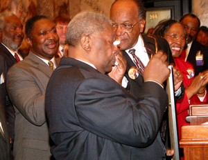 An emotional King is surrounded by Mississippi legislators in Jackso, Miss. as he is presented with a concurrent resolution naming Feb. 15, 200, as B.B. King Day.  (Photo credit: Mississippi Blues Commission)