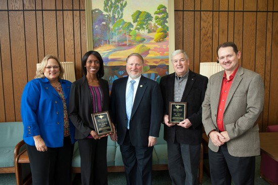 The 2015 Delta State Connected Educator award recipients are Dr. Temika Simmons (holding plaque on left) and Dr. Michael McNeece (holding plaque on right). Beverly Fratesi, Ellucian general manager (left), Provost Dr. Charles McAdams (center), and Edwin Craft, CIO of OIT (right), congratulated the winners.
