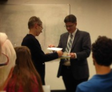 Dr. Stuart Rockoff (right), director of the Mississippi Humanities Council, presents Dr. Michaela Merryday, associate professor of art history, with the 2015 Humanities Teacher Award.