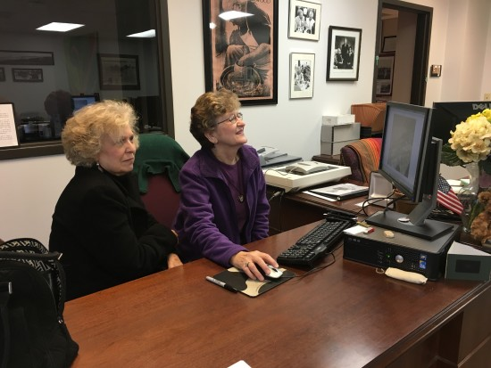 Elaine Lambert, left, and Sandra Baggett, visited the University Archives Department to explore the  Jack Shults collection, a series of digitized negatives.