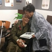 "Reena Evers, daughter of Medgar Evars and Myrlie Evers-Williams, enbraces Annyce Campbell after a presentation of ""Delta Jewels: In Search of My Grandmother's Wisdom"" at the Smithsonian Anacostia Community Museum in Washington, DC."