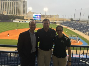 Jeffrey Farris '04/'05 (l to r), director of Alumni Affairs; Brett Walker '05, Hancock Investment Services; Cristina Coca '13, director of Community Relations at MGM Park.
