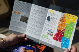 An attendee looks at a brochure illustrating the locations of the thirty-plus Freedom Trail markers.