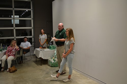 President of the Delta State Leflore County Chapter Miller Arant '99 introducing a future Delta State alum to the crowd.